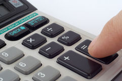 Calculate. Finger pressing result button of calculator. Close-up stock photography