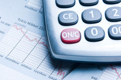 Calculate. Calculator and financial data with graphs. Business concept Stock Images