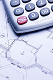 Calculate. A technical design with a calculator Royalty Free Stock Images