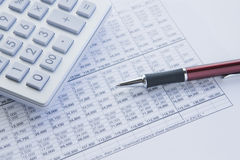 Calculate and balance. Financial balance sheet with calculator and pen Royalty Free Stock Photos