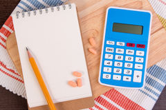 Calculate calories to lose weight. Calorie counting on a paper. Stock Photo