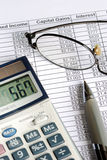 Calculate the capital gain with the calculator Stock Photography