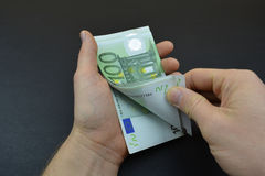 Calculate euro with fingers Royalty Free Stock Photo