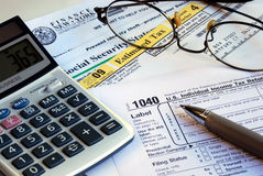 Calculate the income tax return. Calculate the income tax and other tax related documents Stock Image