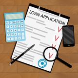 Calculate loan payments top view table Stock Image