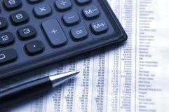Calculate profit. Calculator and pen on financial figures. Duotone Stock Photos
