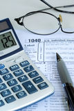 Calculate the United States income tax return. 1040 Stock Photography