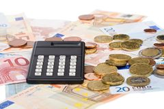 Calculate your profits. Euro bills and cents with a calculator Stock Photography