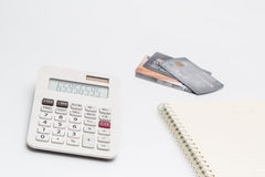 Calculated that the cost or expenses with a credit card. Royalty Free Stock Photo