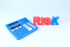 Calculated Risk. Calculator with Risk word on white background stock photography