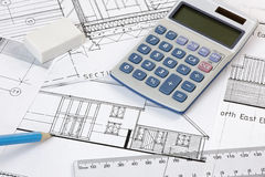 Calculater,pencil and ruler on Plans Royalty Free Stock Photo