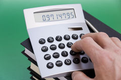Calculating. Accountant using calculator close up view stock images
