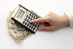 Calculating. Over a fan of money royalty free stock photo