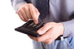 Calculating. Businessman calculating expensess or tax stock photos