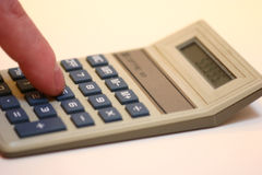 Calculating. Using a Calculator Royalty Free Stock Photos