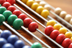 Calculating on an abacus. Abacus with multi coloured beads - concept for education or calculating royalty free stock photos