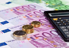 Calculating augmentation of capital. Euro banknotes, coins and calculator stock images