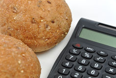 Calculating bread calories. On white Stock Photography