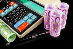 Calculating business revenues on retro style calculator Royalty Free Stock Image