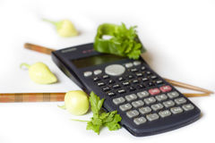 Calculating calories. Sticks and vegetables included. Isolated on white Royalty Free Stock Image