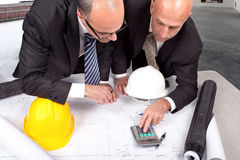 Calculating construction spending cost Royalty Free Stock Photo