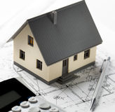 Calculating cost of new house stock photos