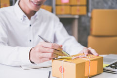 Calculating the cost of postage of a small package Royalty Free Stock Image