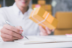 Calculating the cost of postage of a small package Royalty Free Stock Photos