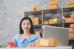 Calculating the cost of postage of a small package Stock Photography