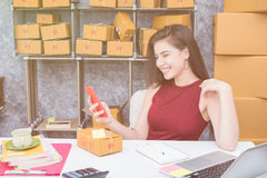Calculating the cost of postage of a small package, Small business enterprise Royalty Free Stock Image