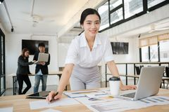 Calculating the cost of postage of a small package, Small business enterprise concerns royalty free stock image