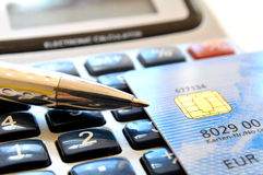Calculating with credit card Royalty Free Stock Image