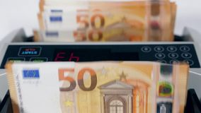 Calculating device is processing euro banknotes. 4K stock video footage