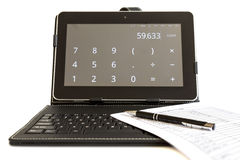Calculating on digital tablet Stock Photography