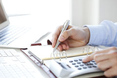 Calculating expenses Stock Photography