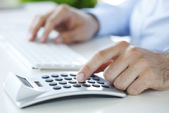 Calculating expenses Royalty Free Stock Images