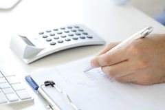 Calculating expenses royalty free stock photo