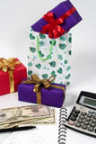 Calculating gift shopping expenses, Stock Photos