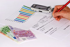 Calculating the Income. The composition suggests growth and the control of income Stock Photography