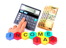 Calculating income tax. Pic depicting calculating income tax on white background stock photography