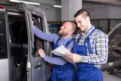 Calculating loss in repair shop Royalty Free Stock Photo