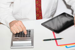 Calculating with mobile computer Stock Photo