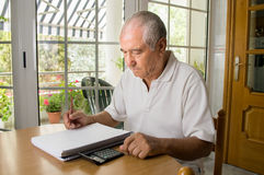 Calculating the monthly expenses Stock Image