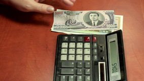 Calculating North Korean money stock footage