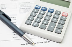 Calculating numbers for bill. With pen and calculator Royalty Free Stock Images