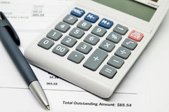 Calculating numbers for bill. With pen and calculator Stock Photos