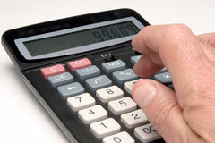 Calculating profits Royalty Free Stock Photo