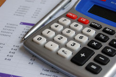 Calculating. Staff hour payroll with time-sheet Royalty Free Stock Images