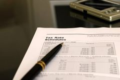 Calculating the tax. Tax rate schedule form, business and finance concept, focus on the notice stock photos