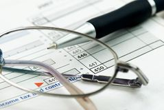 Calculating tax Stock Images